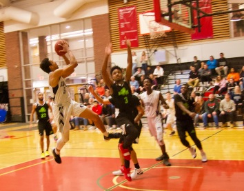 Atencio Martin goes acrobatic against Vermont Tech. Martin would lead all scorers with 30pts leading the SeaWolves to an 82-74 win. All playoff photos courtesy of Cassie-Briana Marceau
