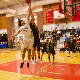 SeaWolf reserve Marcus Bailey reaches for a rebound against an unidentified Vermont Tech player. Bailey would hit for 2pts and grab 4 rebounds in 10 minutes of play